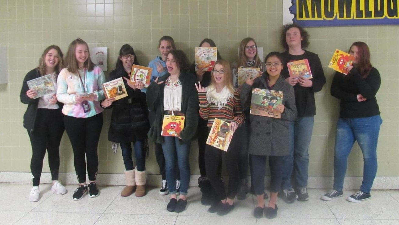 Members of the Interact Club display their books on the first day of the reading