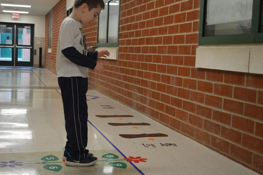 Nathan, a kindergartner at Kennedy Early Childhood Center, enjoys the sensory hallway.