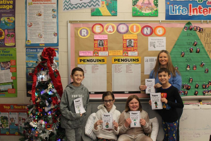 Mrs.Lukowski and her students showing off some cards they made. Students from the left: Bradley Benjamin, Kacey Spencer, Annaleia Rose and Tyler Neapert.