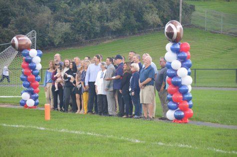 The Distasio family gathers for the scoreboard dedication.