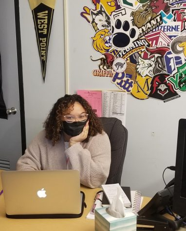 College advisor, Ms. Nin, working at her desk.